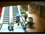 Old Guy Falls Up Escalator