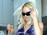 Pam Anderson Arrives At LAX
