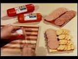 1960s Close Up Woman' S Hands Slicing Baloney Loaf + Putting It On Tray With Crac