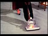 1964 High Angle Close Up Woman Wearing Dress Pushing Vacuum Cleaner Over Grey Ca