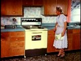 1958 Housewife Demonstrating Features Of Stove Oven W Wave Of Hand Opening