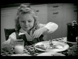 B W 1944 Zoom Out From Girl Drinking Milk To Family Eating Breakfast In