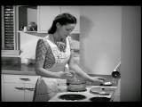 B W 1940s Housewife Standing At Stove Cooking