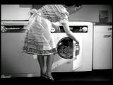 B W 1948 Housewife Loading Laundry Into Dryer Industrial