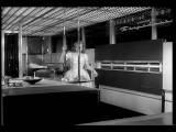 B W 1950s Woman Closing Refrigerator In Futuristic Kitchen