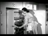 B W 1950 Housewife Opening Refrigerator Checking Butter + Opening Drawer