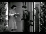B W 1940s Delivery Man Handing Woman Package At Front Door She Tips