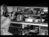 B W 1950s Woman Taking Dish Of Food From Compartment In Futuristic Refrigerator