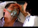 Close Up Female Doctor Stroking Forehead Of Middle-aged Male Patient With Oxygen