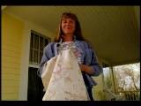 Low Angle MS PORTRAIT Woman Standing On Porch Holding Table Cloth Smiling Mont