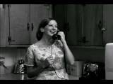 Medium Shot Woman Entering Kitchen, Answering And Talking On Telephone, Then Cup