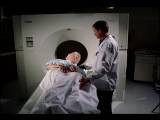 Medium Shot Male Doctor Giving MRI To Senior Female Patient