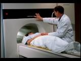 Medium Shot Male Doctor Giving MRI To Female Patient