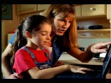 Slow Motion Woman + Girl Sitting In Front Of Laptop Computer Typing On Keyboard