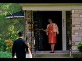 Wide Shot Vacuum Salesman Talks To Woman On Front Porch Of House