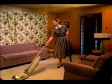 Wide Shot Woman Vacuuming Living Room, Stopping And Drinking From Cocktail Glass